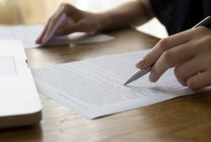 Hand with Pen Proofreading