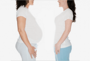 Two women standing opposite each other - surrogacy