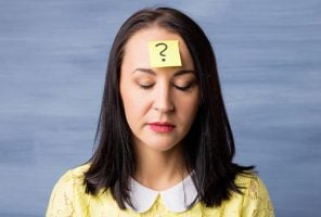 Woman with sticky note on her forehead
