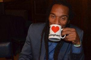 Benjamin Zephaniah with a 'I love Birmingham' mug
