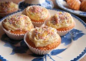 A plate of iced fairy cakes