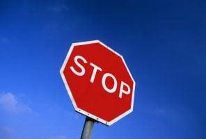 stop roadsign at road junction UK