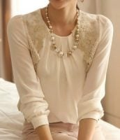 An antique lace-style white top looks equally lovely with jeans, smart trousers or a pencil skirt. Lovely!