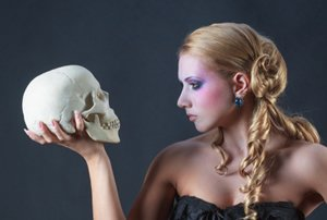 Woman looking at skull