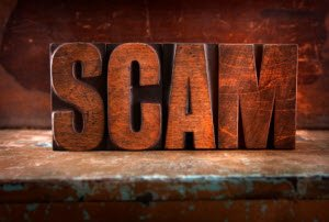 online scams: SCAM woodblocks