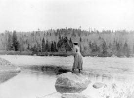 1024px-Woman_fly_fishing_in_Nova_Scotia_Canada_ca__1900-300x219