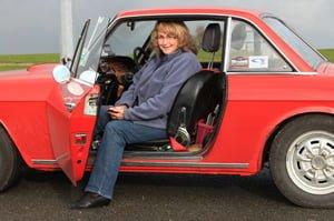 Calm Carol in the passenger seat
