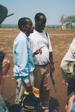 Men talking - one holding a gun