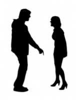 man and woman arguing in silhouette