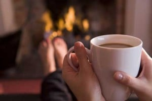 hot drink in front of roaring fire