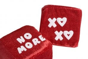 Two red dice love and kisses and no more