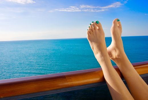 Putting your feet up on a cruise, blue sea, blue sky and blue nail varnish
