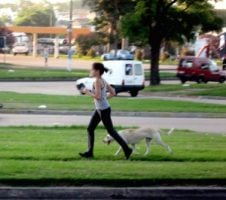 Women jogging with her dog