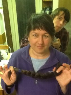 Tracey holding her plait of hair