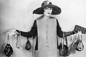 1920s woman holding lots of handbags