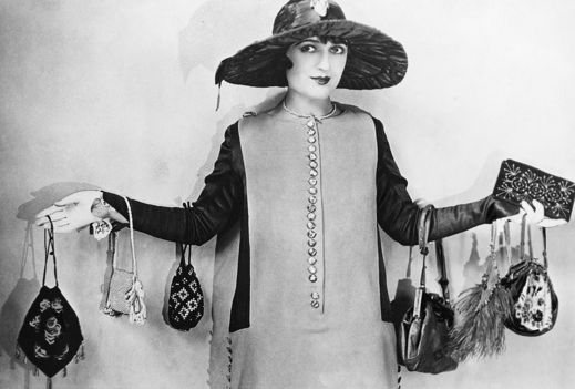 1920s woman carry lots of handbags