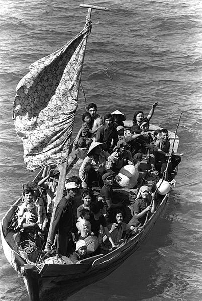 Vietnamese boat people in a boat