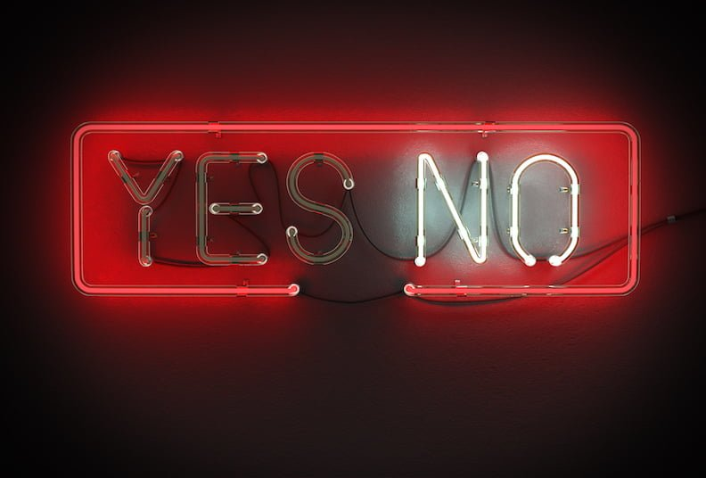 Yes or No sign made from neon alphabet on a black background.