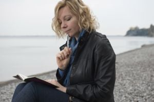 Woman poet by the sea
