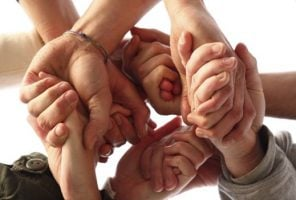 Hands all linking together