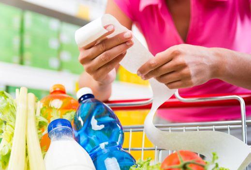 Woman shopper checking her list