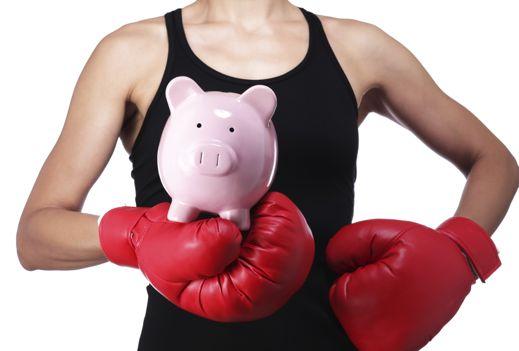 woman wearing boxing gloves wearing saving pig