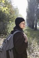 Woman enjoying outdoor walk with rucksack