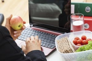 Dieting woman working at laptop