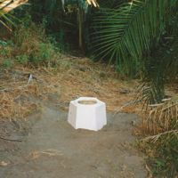 Loo in clearing in Botswana. Plastic seat over hole in ground but marvellous view of the dawn