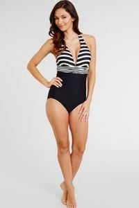 woman in a tummy control swimsuit in black and white