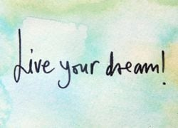 Live your dream written on a blue-washed background