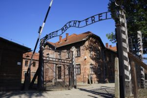 Gates of Auschwicz with the 'Arbeit Macht Frei' sign over the entrance (which translates as 'work sets you free')