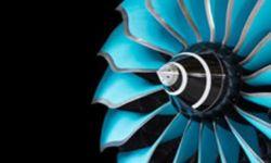 Blue aeroplane engine on a black background