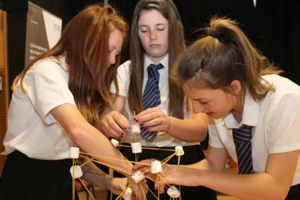 STEM: Three young women working together on an engineering project