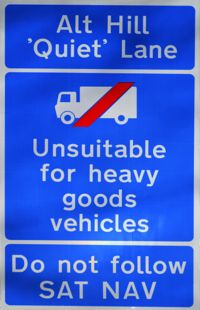 Road sign saying unsuitable for heavy goods vehicles