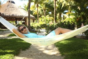 Woman relaxing in a hammock in the shade