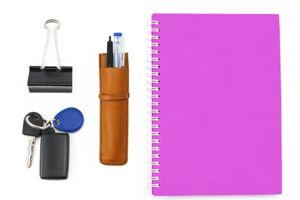 Notebook stationery and key isolated on white background