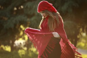 Woman in a red cape in nature