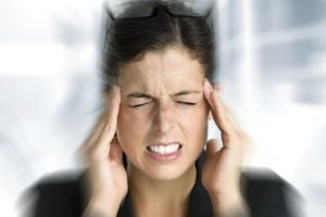 Woman with intense painful migraine