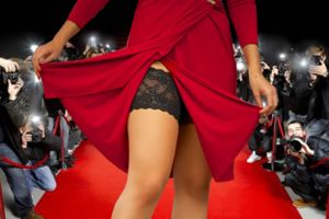 Woman in a red dress on the red carpet wearing bandelettes