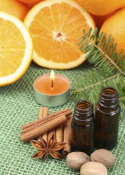 aromatherapy - perfect for winter time - candles and oranges