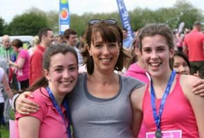 Sue Pringle, the article author, with her daughters in the Race for Life