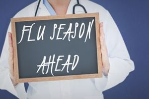 Doctor in a white coat holding a sign that says flu season ahead
