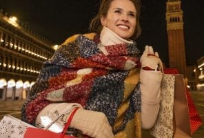 Woman in a winter coat and red, blue mustard wrap