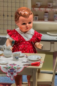 Doll with tea set