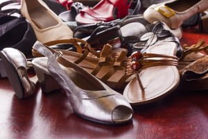 decluttering: clearing out piles of shoes