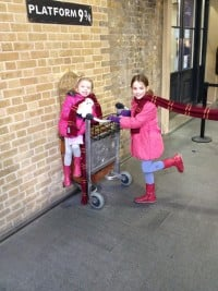 Young girls on the platform at Kings Cross 9 3/4 where Harry Potter was filmed