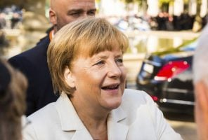 Frankfurt, Germany - October 3, 2015: German Chancellor and Leader of the German Christian Democratic Union (CDU) Angela Merkel arrives for the opening celebration of the Day of German Unity to mark the reunification of East and West Germany in 1990.