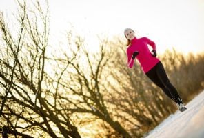 Woman running outdoors on a cold winter day