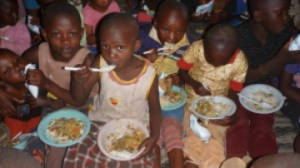 Children eating from the plates